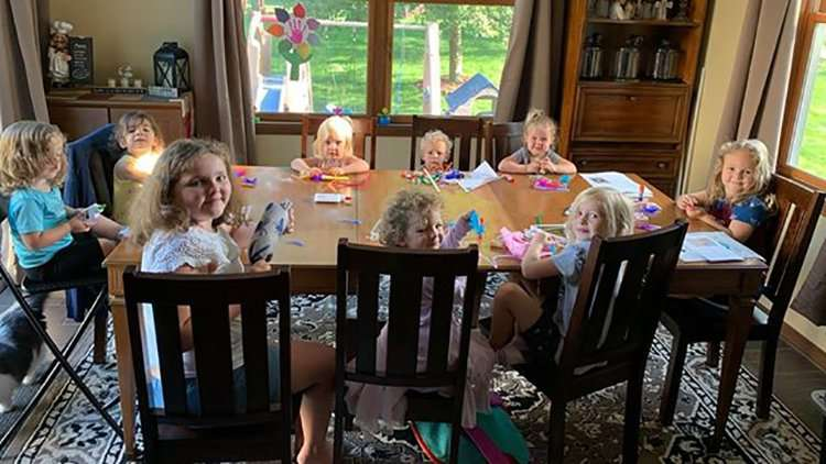 Kids working on RSR animal kids at the dining table