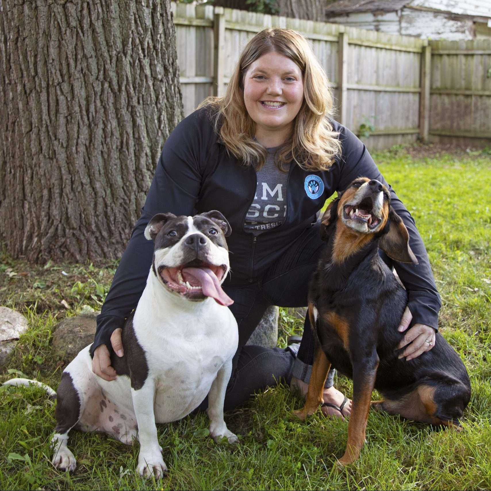 Julie Olson poses with two dogs