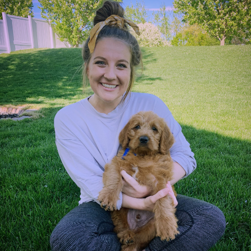 Emily Lewis poses with her dog Quincy