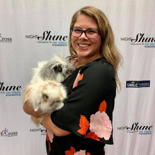 Mackenzie Albrecht poses with two bunnies