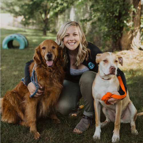 Nicole Samborski poses with two dogs