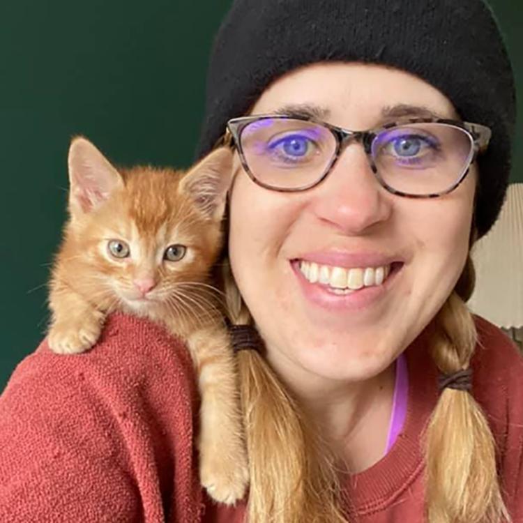 Kitten on her foster mom's shoulder
