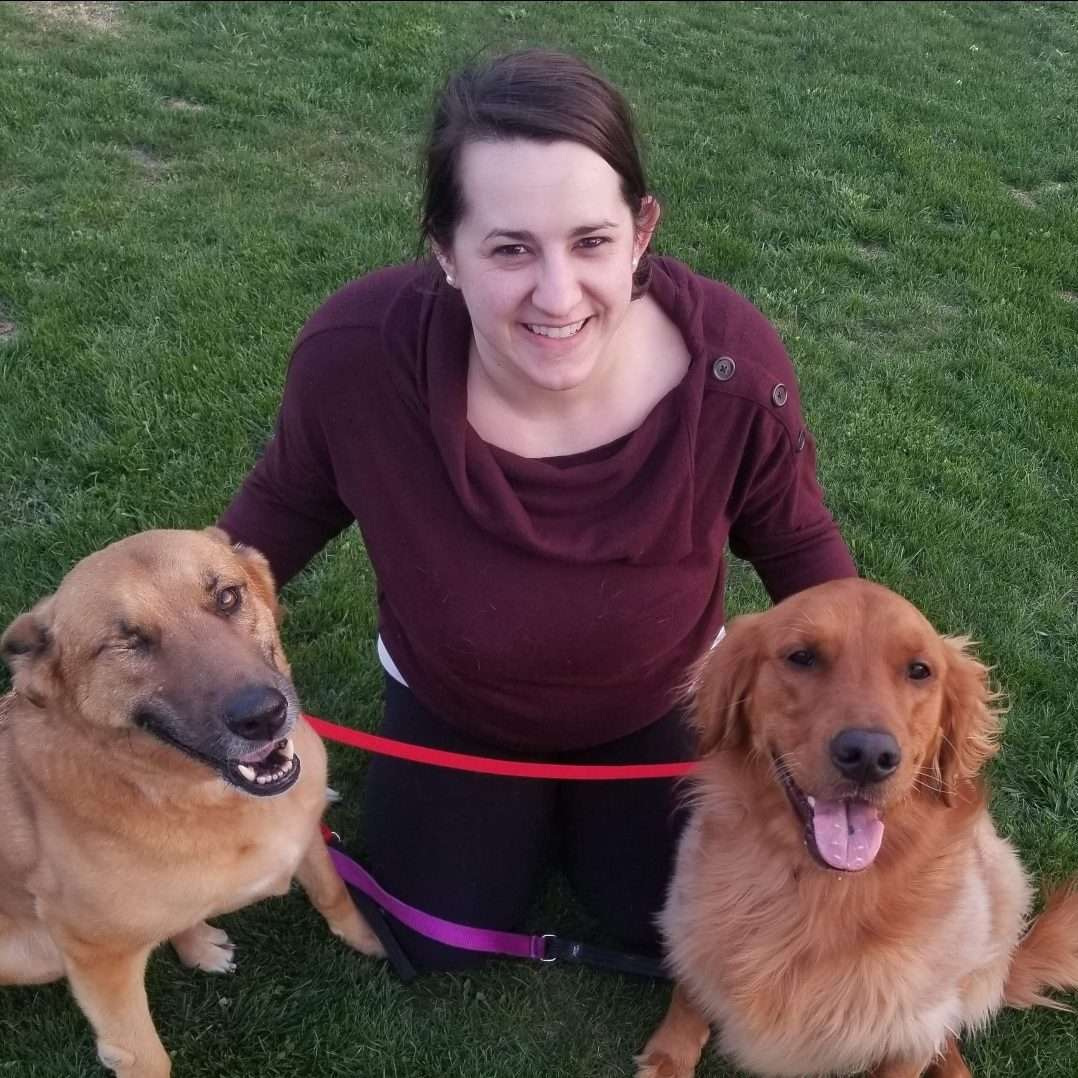 Amber Wiesender poses with two dogs