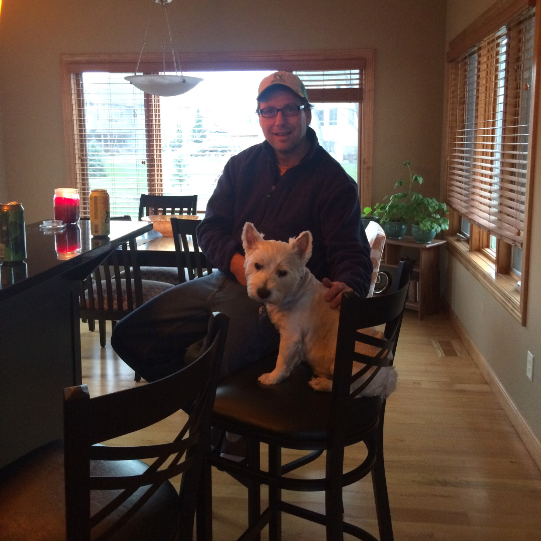 rocco sitting on a bar stool with chad