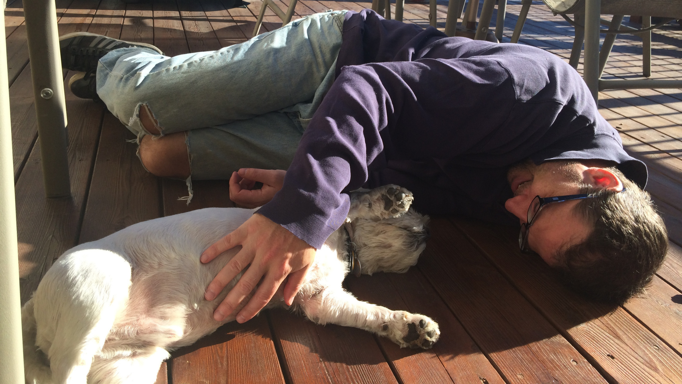 chad laying on the ground with Rocco